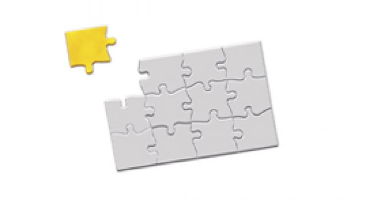 Jigsaw puzzle with a missing golden piece to complete