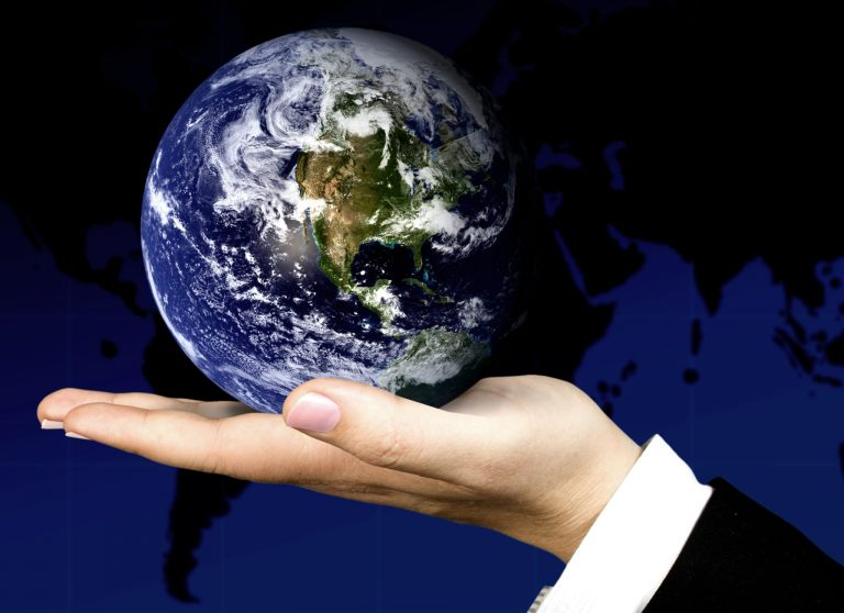 business hand holding a globe